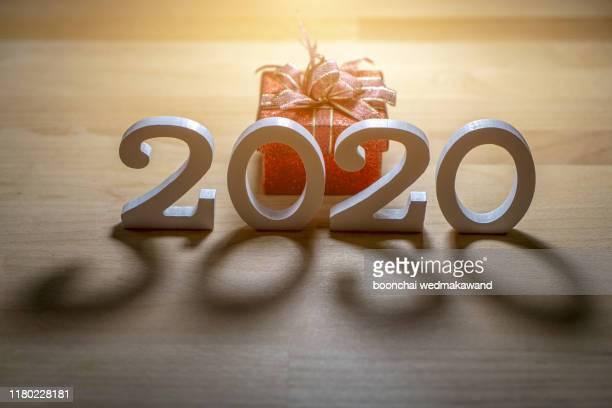 new year 2019 change to 2020 concept, hand change wooden cubes - 2020 calendar stock photos and pictures