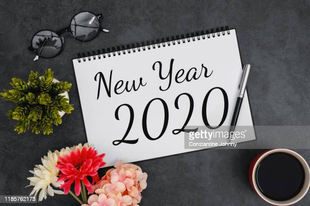 new year 2020 on notebook - 2020 calendar stock photos and pictures