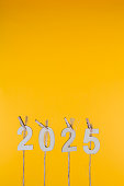 New Year 2025 Concepts Clipped Cards on yellow background
