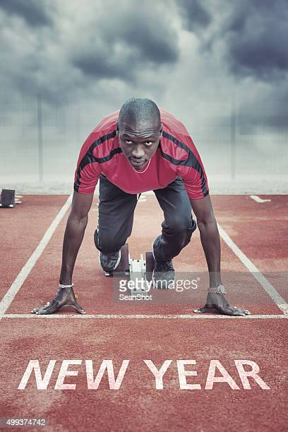 New Year. Athlete in the starting blocks