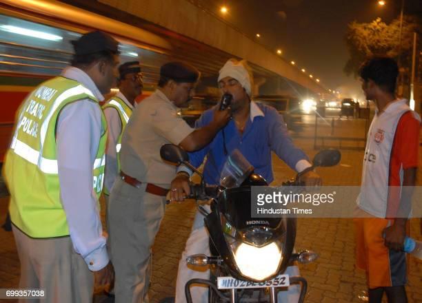 New Year Celebration Drunken Driving Drink Driving Traffic Police take a breathe test of mumbaikar on 31st night at Sahara Star Santacruz signal in...