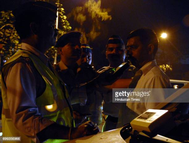 New Year Celebrations Drunken Driving Drink Driving Traffic Police check level of liquor consumed by Taxi Driver on 31st night at Andheri subway in...