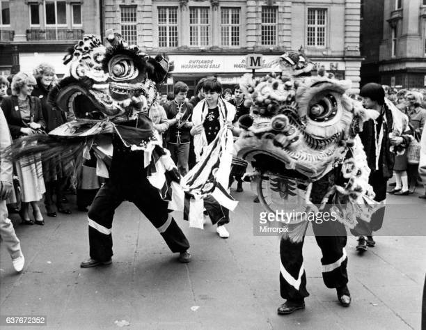 New Year Chinese style. A festive Dragon dance underway at Grey's Monument, Newcastle. 15th February 1983.