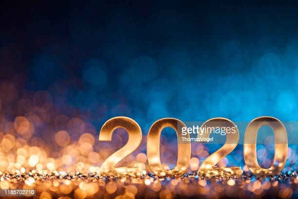 new year christmas decoration 2020 - gold blue party celebration - new year's eve stock pictures, royalty-free photos & images