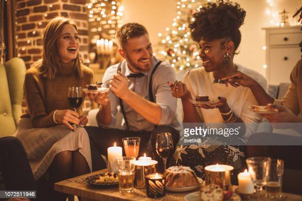 new year dinner party - new year's eve stock pictures, royalty-free photos & images