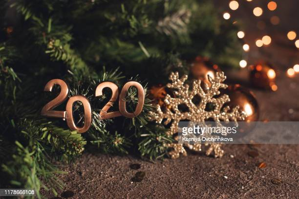 2020 new year eve trip.top view putting happy new year number on wood table with adventure accessory item,holiday vacation resolutions planning - new year 2020 stock photos and pictures
