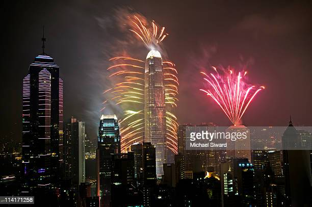new year fireworks from hong kong - michael siward stock pictures, royalty-free photos & images