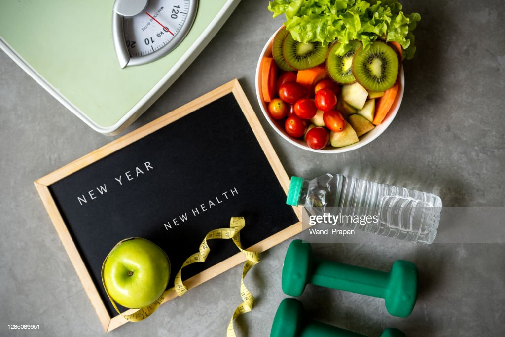 New Year for New Healthy 2021.  Fresh vegetable salad and healthy food for sport equipment for women diet slimming weight loss background. : Stock Photo