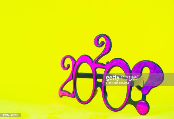 202? new year glasses on yellow background - 2020 2029 stock pictures, royalty-free photos & images