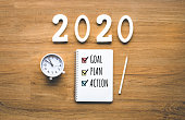 2020 new year goal,plan,action text on notepad on wood background.Business challenge.Inspiration ideas