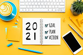 2021 new year goal,plan,action text on notepad with office accessories.Business management,Inspiration concepts