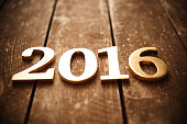 New year gold (metal) text on wood