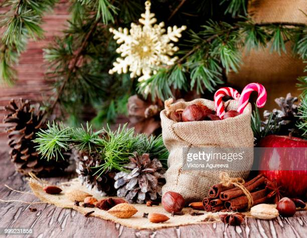 new year or christmas composition with walnuts, mulled wine wood background, selective focus - christmas background stock photos and pictures