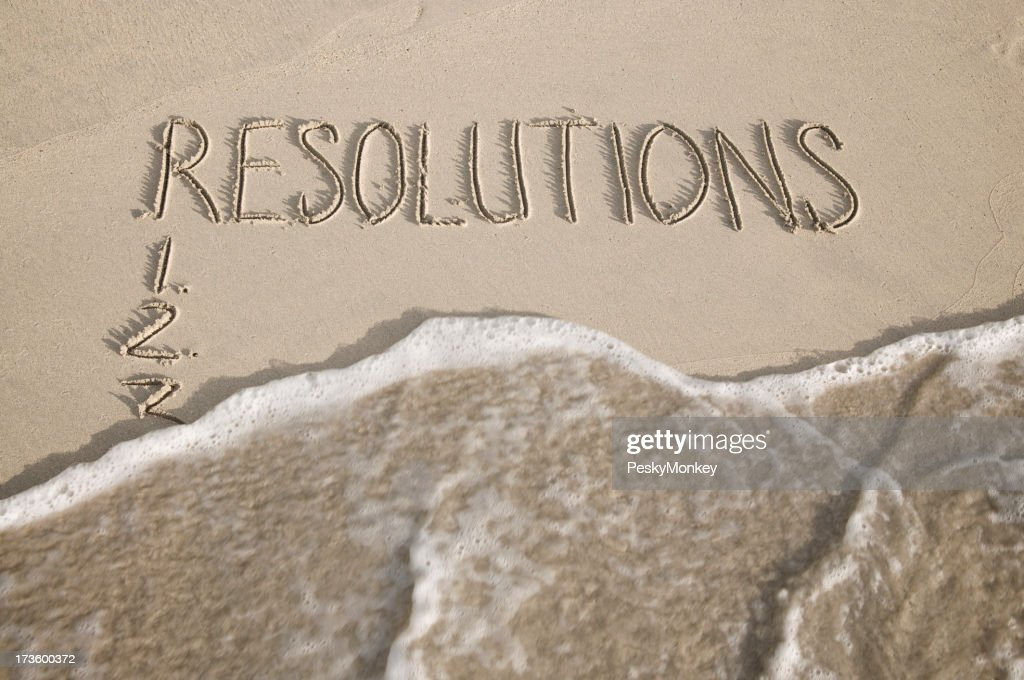 New Year Resolutions Wiped Away Message On Smooth Sand Beach Stock ...