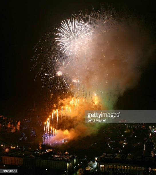 New Year revelers enjoy the firework display on Princes Street January 1, 2008 in Edinburgh, Scotland. It is expected that around one hundred...