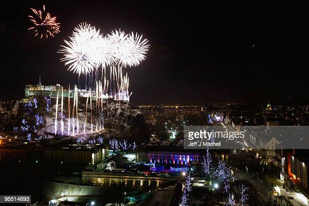 New Year revellers enjoy the firework display above Edinburgh Castle on January 1 2010 in Edinburgh Scotland It is expected that around eighty...