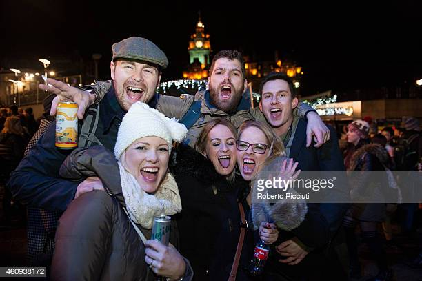 New Year revellers gather on Princes Street ahead of the New Year celebrations on December 31, 2014 in Edinburgh, Scotland.