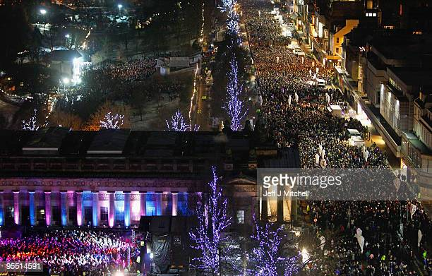 New Year revellers gather on Princes Street during the Hogmanay party on December 31 2009 in Edinburgh Scotland It is expected that around eighty...