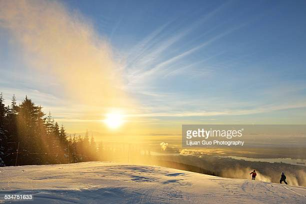 new year's day sunrise at grouse mountain ski hill - grouse mountain stock photos and pictures