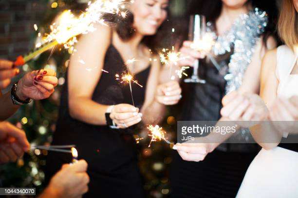 new year's eve celebration - christmas party stock photos and pictures