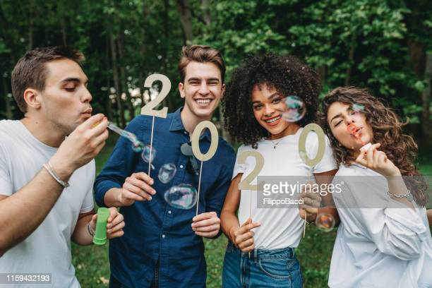 2020 new years eve: celebration with friends - happy new year 2020 stock photos and pictures