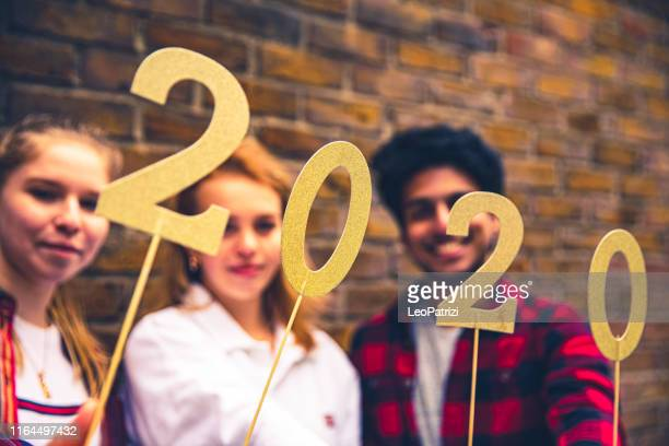 new years eve celebrations - teenagers - 16 17 years stock pictures, royalty-free photos & images