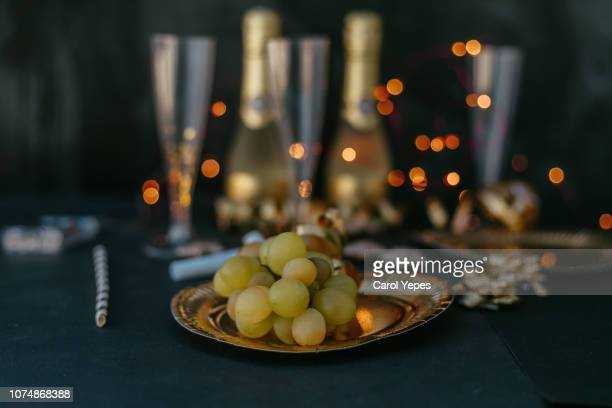 new years eve festive tablecloth and grapes - champagne coloured stock photos and pictures