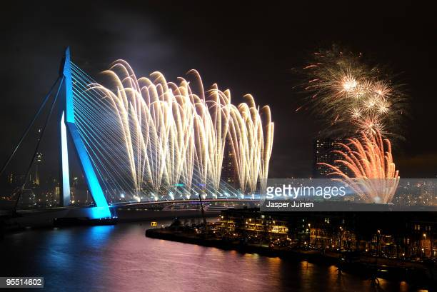 New Year's Eve fireworks display illuminates the sky over the Erasmus Bridge crossing the Nieuwe Maas river on January 1 2010 in Rotterdam The...