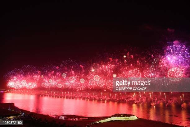 New Year's Eve fireworks erupt over Ras al-Khaimah, one of the world's largest fireworks shows on January 1, 2021.