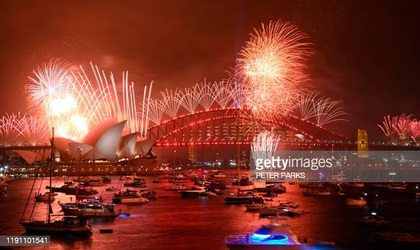 TOPSHOT New Year's Eve fireworks erupt over Sydney's iconic Harbour Bridge and Opera House during the fireworks show on January 1 2020