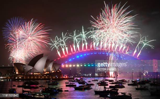 New Year's Eve fireworks erupt over Sydney's iconic Harbour Bridge and Opera House during the fireworks show on January 1 2020