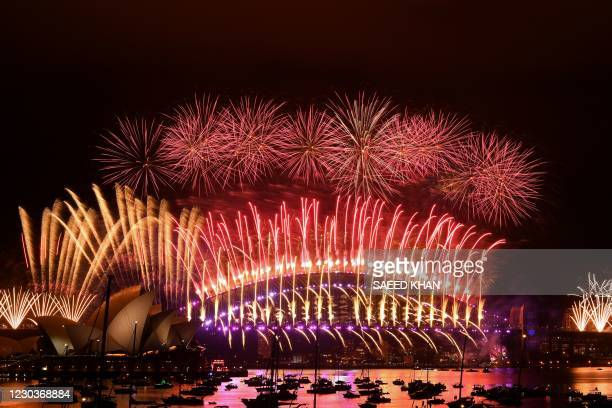 New Year's Eve fireworks erupt over Sydney's iconic Harbour Bridge and Opera House during the fireworks show on January 1, 2021.