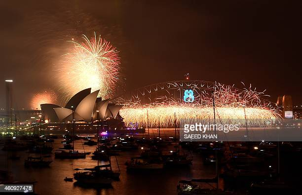 New Year's Eve fireworks erupt over Sydney's iconic Harbour Bridge and Opera House during the traditional early family fireworks show held before the...