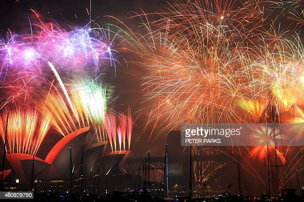 New Year's Eve fireworks erupt over Sydney's iconic Harbour Bridge and Opera House during the traditional fireworks show held at midnight on January...