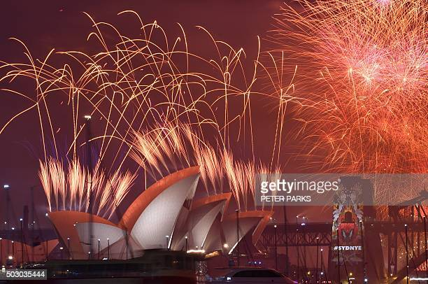 New Year's Eve fireworks erupt over Sydney's iconic Harbour Bridge and Opera House during the traditional fireworks show held at midnight early on...