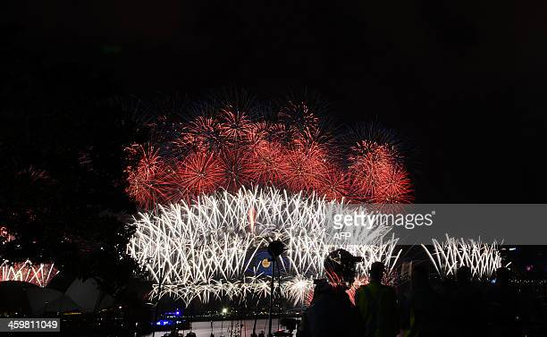 New Year's Eve fireworks erupt over Sydney's iconic Harbour Bridge on January 1 2014 Tonnes of explosives lit up Australia's biggest city with...