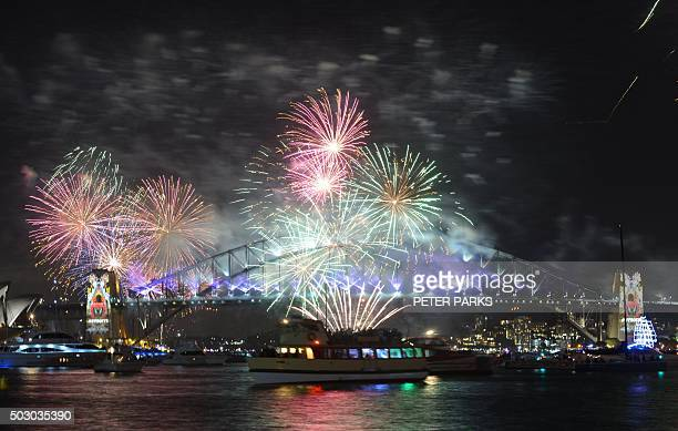 New Year's Eve fireworks erupt over Sydney's iconic Harbour Bridge during the traditional fireworks show held at midnight early on January 1 2016 AFP...