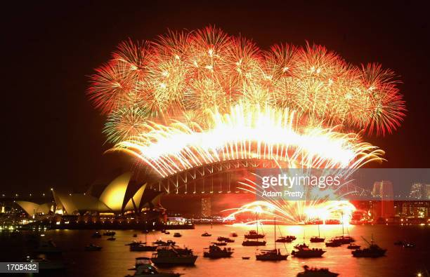 New Year's Eve fireworks explode in the sky above Sydney Harbour on December 31 2002 in Sydney Australia A crowd of approximately 800000 people...