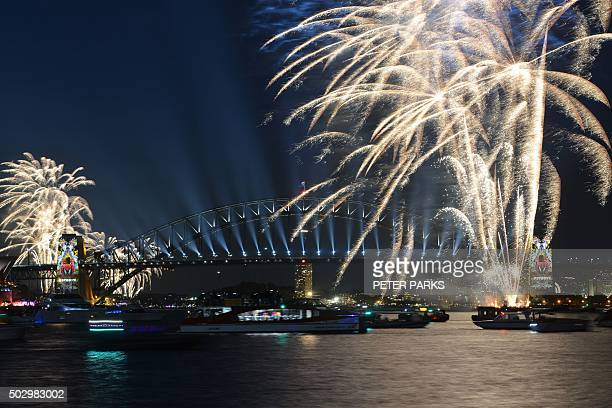 New Year's Eve fireworks illuminate Sydney's iconic Harbour Bridge and Opera House during the traditional early family fireworks show held before the...