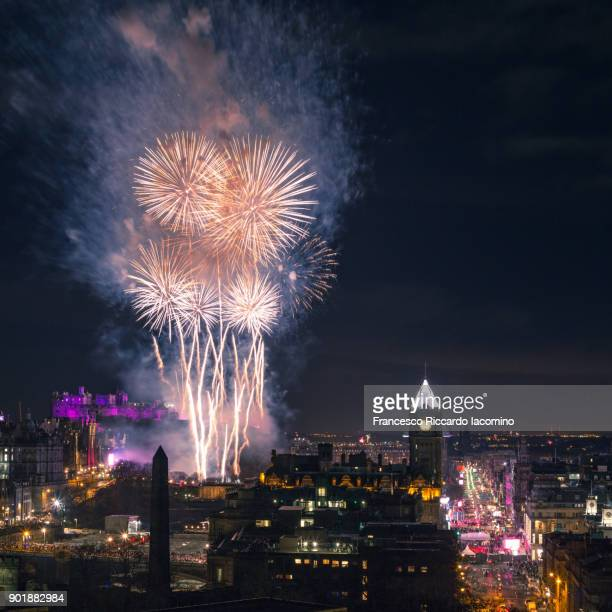new year's eve hogmanay in edinburgh - hogmanay stock pictures, royalty-free photos & images