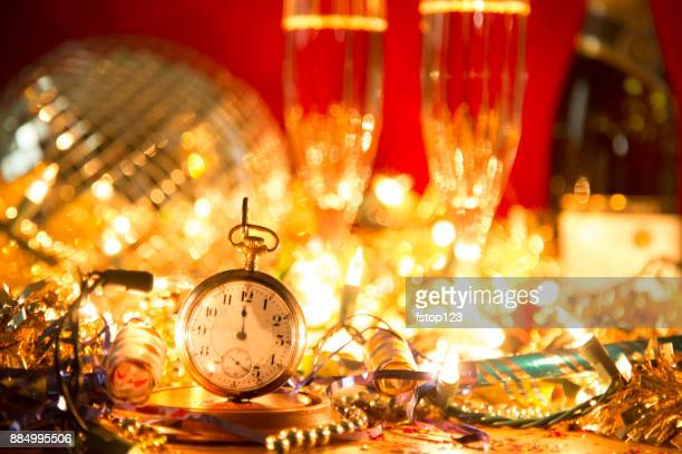 new year's eve holiday party, pocket watch, clock at midnight. - table after party stock pictures, royalty-free photos & images