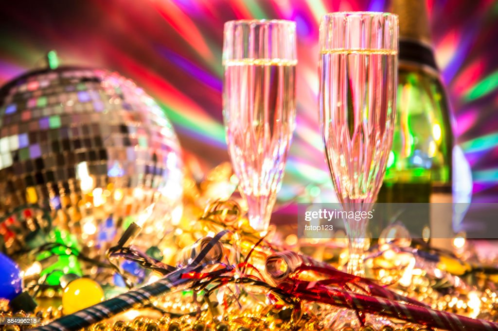 New Year's Eve holiday party with champagne, disco ball, decorations. : Stock Photo