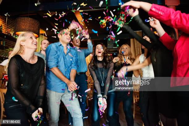 new years eve in a bar between group of coworkers and colleagues - 25 29 years photos stock photos and pictures