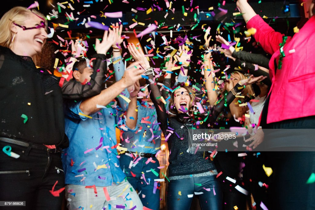 New Years Eve in a bar between group of coworkers and colleagues : Stock Photo