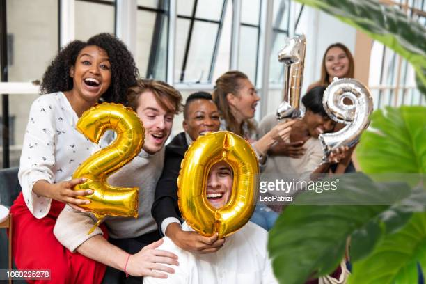 new year's eve is coming! colleagues celebrate the new year in the new york office - 2019 stock pictures, royalty-free photos & images