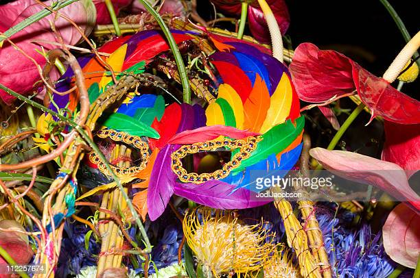 new years eve mask and flowers - carnival stock photos and pictures