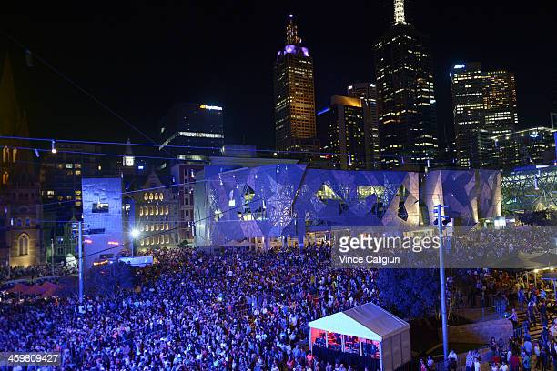 New Year's Eve revelers party in Federation Square during New Years Eve on December 31 2013 in Melbourne Australia