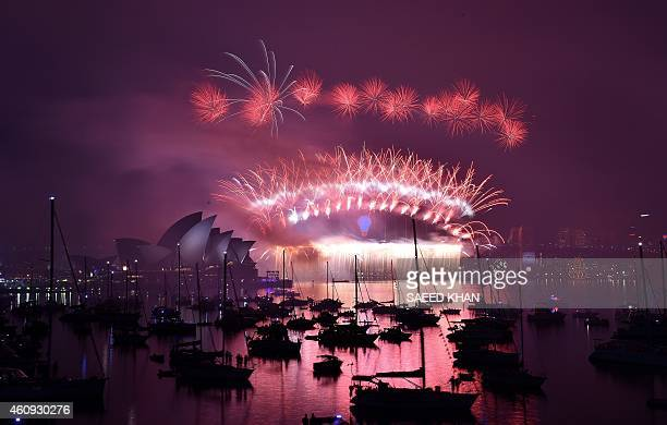 New Year's fireworks erupt over Sydney's iconic Harbour Bridge and Opera House during the traditional fireworks at midnight on January 1 2015 AFP...
