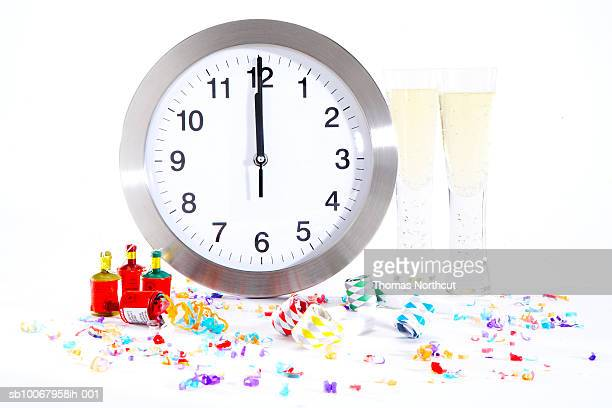 New Year's party decorations and clock on white background