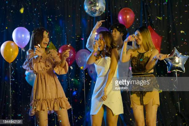 new year's party with friend. - 25 29 years stock pictures, royalty-free photos & images